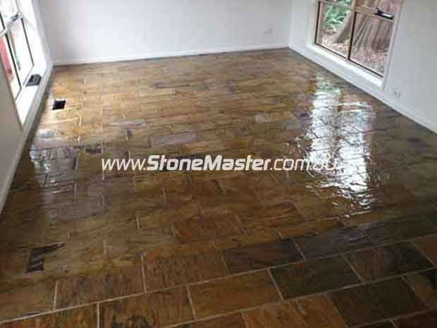 large bedroom with slate tiles after sealing with glossy sealer empty room regular pattern