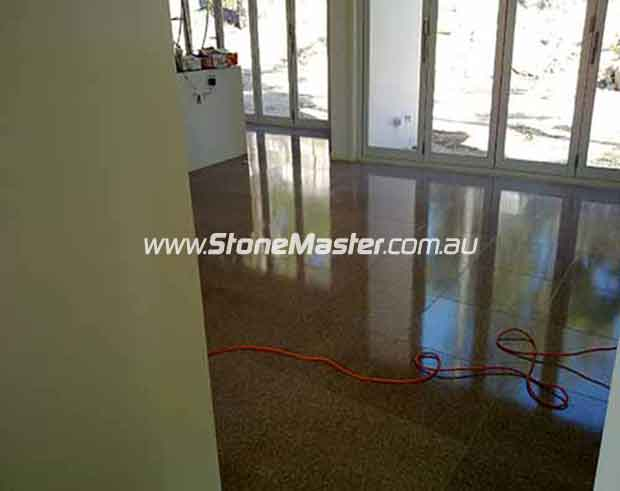 terrazzo tiles with light shadow from windows during cleaning job
