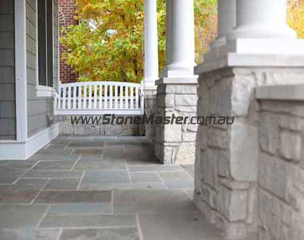 bluestone tiles outdoor entrance white grout lines