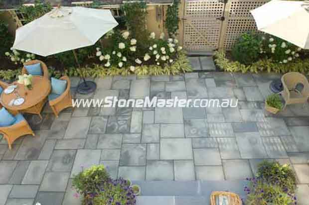 bluestone tiles outdoor patio irregular pattern dark grout eclectic landscape
