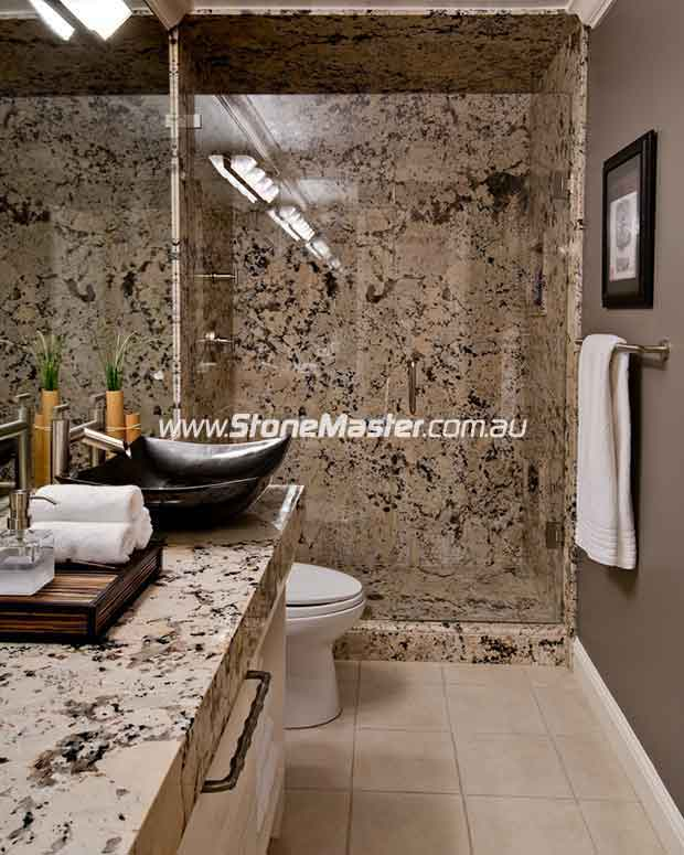 bathroom with granite shower walls