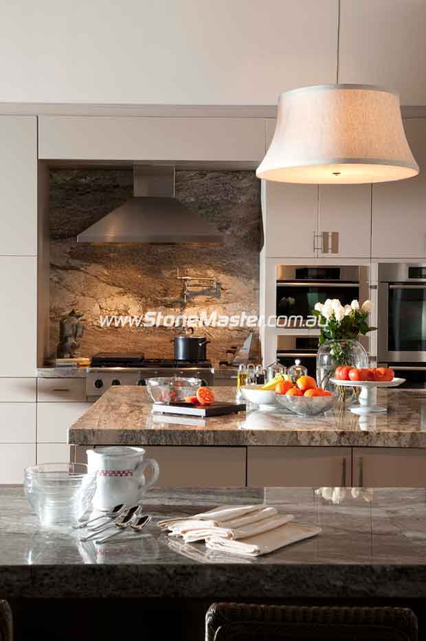 traditional kitchen with shiny granite table