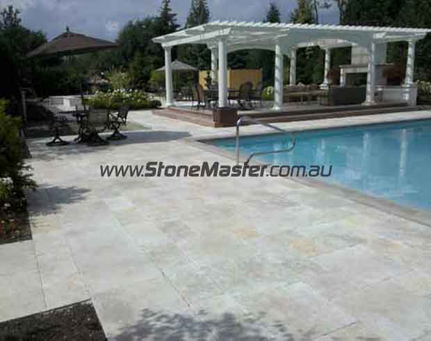 paving stone tumbled marble with bluestone coping traditional pool
