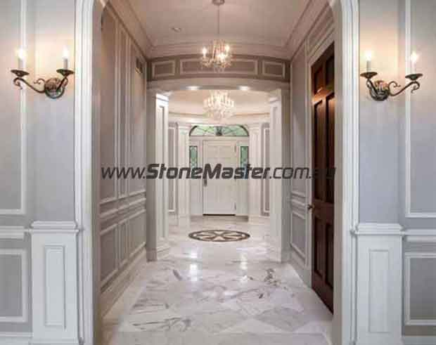 traditional entry with polished marble tiles dark vines