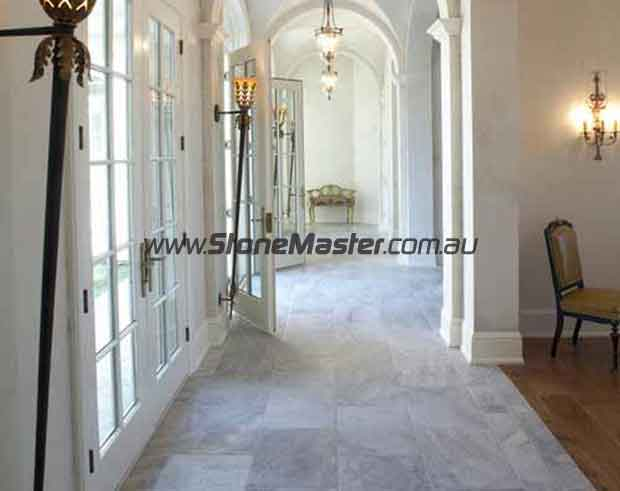 traditional hall with polished marble tiles regular pattern thin grout lines